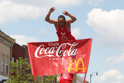 Mike Greene - mgreene@shawmedia.com A member of the Jesse White Tumblers flies through the air during the 71st Annual Milk Days Parade Saturday, June 2, 2012 in Harvard.