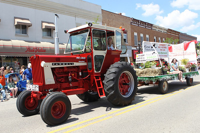 Mike Greene - mgreene@shawmedia.com Pihl Farms of Harvard tows a float with a tractor through  downtown during the 71st Annual Milk Days Parade Saturday, June 2, 2012 in Harvard.