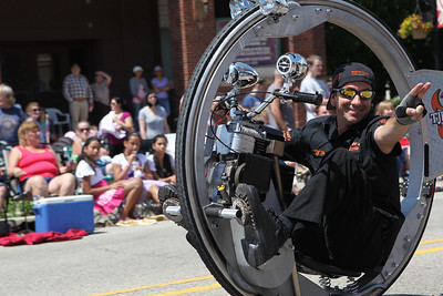 Mike Greene - mgreene@shawmedia.com A representative from TJ Howell rides a rocket cycle during the 71st Annual Milk Days Parade Saturday, June 2, 2012 in Harvard.