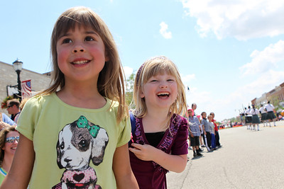 Mike Greene - mgreene@shawmedia.com Paige Johnson (left), 5 of Marengo, and Brooke Ameskamp, 5 of Marengo, laugh while watching the 71st Annual Milk Days Parade Saturday, June 2, 2012 in Harvard.