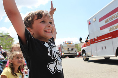 Mike Greene - mgreene@shawmedia.com Casen Patnaude, 5 of Poplar Grove, cheers for candy during the 71st Annual Milk Days Parade Saturday, June 2, 2012 in Harvard.
