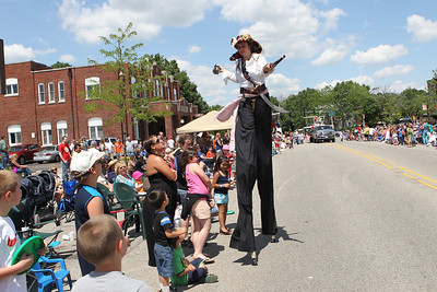 Mike Greene - mgreene@shawmedia.com An entertainer on stilts walks past the crowds during the 71st Annual Milk Days Parade Saturday, June 2, 2012 in Harvard.