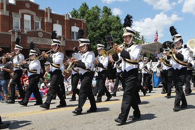 Mike Greene - mgreene@shawmedia.com The Harvard High School Hornets marching band performs during the 71st Annual Milk Days Parade Saturday, June 2, 2012 in Harvard.