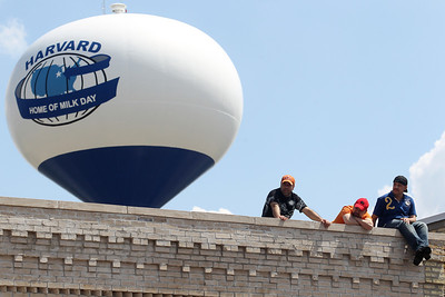 Mike Greene - mgreene@shawmedia.com A group of men watch from a rooftop during the 71st Annual Milk Days Parade Saturday, June 2, 2012 in Harvard.