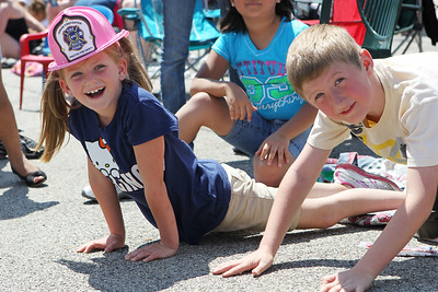 Mike Greene - mgreene@shawmedia.com Kendall Gallaugher and her brother Eli peer around other spectators to get a look at what was coming up during the 71st Annual Milk Days Parade Saturday, June 2, 2012 in Harvard.