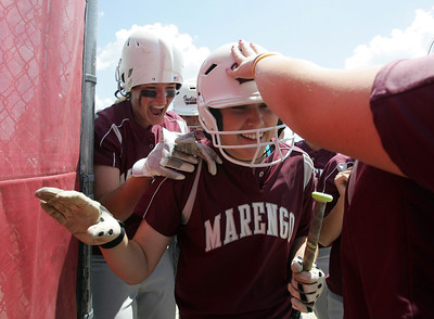 H. Rick Bamman - hbamman@shawmedia.com Marengo's Reed Karsten is welcomed by teammates back to the dugout after her inside the park home run against Burlington Central.