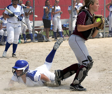 H. Rick Bamman - hbamman@shawmedia.com Marengo's Taylor Carlson (right) has Burlington Central's Lauren King out at the plate for the second out in the fifth inning of the  Belvidere 3A Softball sectional Saturday, June 2, 2012. Marengo won 3-0.