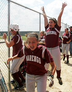 H. Rick Bamman - hbamman@shawmedia.com The Marengo bench celebrates after Reed Karsten's inside the park home run in the third inning against Burlington Central in the Belvidere 3A Softball sectional Saturday, June 2, 2012.
