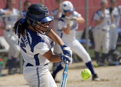 H. Rick Bamman - hbamman@shawmedia.com Burlington Central's Haley Albamonte takes a swing at a Lindsay Melson pitch.