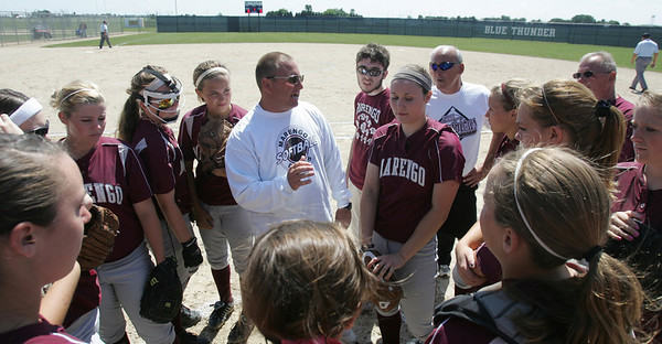 H. Rick Bamman - hbamman@shawmedia.com Marengo coach Dwain Nance gathers his team prior to the start of the Belvidere 3A Softball sectional Saturday, June 2, 2012.
