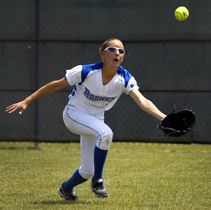 H. Rick Bamman - hbamman@shawmedia.com Burlington Central's Courtni Neubauer races to catch a flyball for the second out in the fouth inning against Marengo in the Belvidere 3A Softball sectional Saturday, June 2, 2012. Marengo won 3-0.
