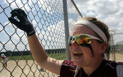 H. Rick Bamman - hbamman@shawmedia.com Marengo's Abby Kissack shouts encouragement from the bench during the Belvidere 3A Softball sectional Saturday, June 2, 2012. Marengo won 3-0.