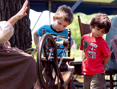 "John Konstantaras/for the Northwest Herald Rylind, 4, (left) and Jaxson, 3, Chess from Lake in the Hills learn about 19th century life as they watch a yarn spinning exhibit at the  ""A Day on the Farm"" program at the Colonel Palmer House. The Crystal Lake Park District and the Crystal Lake Historical Society sponsored the event that focused on the contributions of birds and honeybees to pioneer farm life. The program held at the Colonel Palmer House also featured displays detailing 19th century life in Crystal Lake."