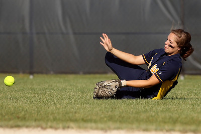 Mike Greene - mgreene@shawmedia.com Sterling's Karlie Mellott comes up short on a ball in the outfield during the Class 3A Belvidere North Sectional Final against Marengo Monday, June 4, 2012 in Belvidere. Marengo won the game 2-1 to take home the sectional title.