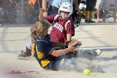 Mike Greene - mgreene@shawmedia.com Marengo's Bethany Hart slides into home plate as Sterling's Ashli King attempts to recover the ball during the Class 3A Belvidere North Sectional Final Monday, June 4, 2012 in Belvidere. Marengo won the game 2-1 to take home the sectional title.