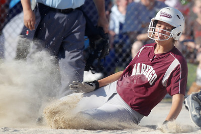 Mike Greene - mgreene@shawmedia.com Marengo's Megan Semro slides into home plate during the sixth inning of the Class 3A Belvidere North Sectional Final against Sterling Monday, June 4, 2012 in Belvidere. Marengo won the game 2-1, with Semro's run being the difference.