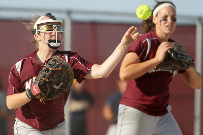 Mike Greene - mgreene@shawmedia.com Marengo's Abby Kissack fields a ball on the infield during the Class 3A Belvidere North Sectional Final against Sterling Monday, June 4, 2012 in Belvidere. Marengo won the game 2-1 to take home the sectional title.