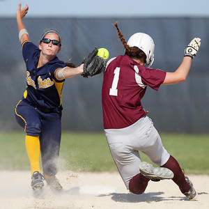 Mike Greene - mgreene@shawmedia.com Sterling's Karlie Mellott (left) attempts to tag Marengo's Reed Karsten during the Class 3A Belvidere North Sectional Final Monday, June 4, 2012 in Belvidere. Karsten was safe on the play. Marengo won the game 2-1 to take home the sectional title.