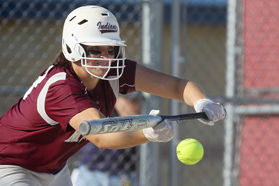 Mike Greene - mgreene@shawmedia.com Marengo's Lindsay Melson bunts to move the runner over during the sixth inning of the Class 3A Belvidere North Sectional Final against Sterling Monday, June 4, 2012 in Belvidere. Marengo won the game 2-1 to take home the sectional title.