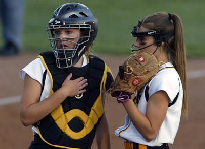 H. Rick Bamman - hbamman@shawmedia.com Jacobs' Kelsey Cunnings (left) and Katie Kirker have a disscussion during a time out during the IHSA Class 4A Girls Softball Supersectional Monday, June 4, 2012 at Judson University in Elgin.
