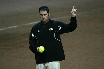 H. Rick Bamman - hbamman@shawmedia.com Jacobs' coach Jeremy Bauer signals to the bench.