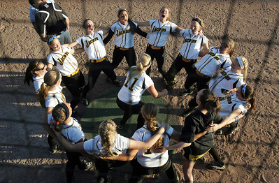H. Rick Bamman - hbamman@shawmedia.com Jacobs' Maggie Hansen (11)  leads teammates in a cheer before the start of the IHSA Class 4A Girls Softball Supersectional Monday, June 4, 2012 at Judson University in Elgin. Jacobs lost 4-1.