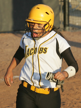 H. Rick Bamman - hbamman@shawmedia.com Jacobs' Nicky Chapa reacts as she crosses the plate to score a run after an illegal pitch.