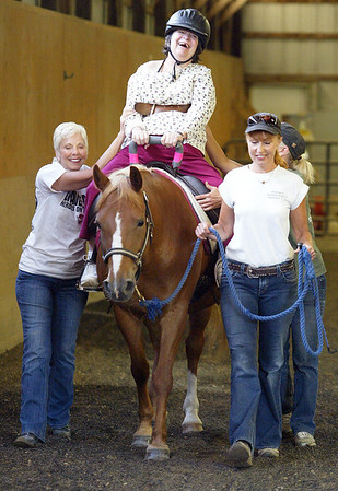 H. Rick Bamman - hbamman@shawmedia.com Passages Hospice patient Ruth Dewitt rides Tali as volunteers Janet Dobson GM mgr Kemper Lakes Golf Club (left) Lissa Ignoffo (right) and Sue Jackson (partially hidden) guide the pair during a recent session at the facility near Harvard.