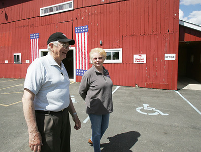 H. Rick Bamman - hbamman@shawmedia.com Dr. Rolf Gunnar and Marge Gunnar founders of the Bravehearrts Therapeutic Riding Center in 2003 walk by the barn and arena at the facility on Maxson Rd. near Harvard.