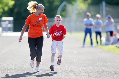 Mike Greene - mgreene@shawmedia.com Nicole Cleeton, of Elmhurst, helps guide Seth Martinez, 10 of Algonquin, while racing during the 5th Annual Run & Roll Track Meet Wednesday, June 6, 2012 at McCracken Field in McHenry. The event included participants of all ages with physical and visual disabilities and introduced the county to paralympians Patrick Byrne and Sheila O'Neil.