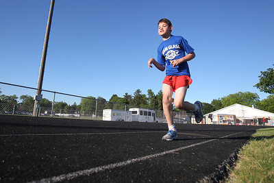 Mike Greene - mgreene@shawmedia.com Aaron Holzmueller, 12 of Evanston, runs in the 800-meter competition during the 5th Annual Run & Roll Track Meet Wednesday, June 6, 2012 at McCracken Field in McHenry. The event included participants of all ages with physical and visual disabilitie.