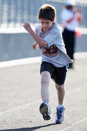 Mike Greene - mgreene@shawmedia.com Samuel Reiter, 11 of Cary, races during the 5th Annual Run & Roll Track Meet Wednesday, June 6, 2012 at McCracken Field in McHenry. The event included participants of all ages with physical and visual disabilitie.