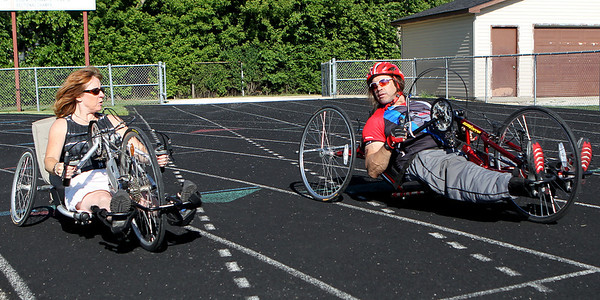 Mike Greene - mgreene@shawmedia.com Paralympic athlete Sheila O'Neil talks with Mike Napp while trying out a hand cycle before the 5th Annual Run & Roll Track Meet Wednesday, June 6, 2012 at McCracken Field in McHenry. The event included participants of all ages with physical and visual disabilitie.