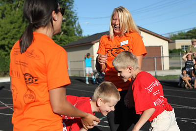 Mike Greene - mgreene@shawmedia.com Nicole Cleeton, of Elmhurst, laughs while speaking with Sarah Iuorio (left), of Palatine, after the pair helped Ethan (left) and Seth Martinez, both 10 of Algonquin, race during the 5th Annual Run & Roll Track Meet Wednesday, June 6, 2012 at McCracken Field in McHenry. The event included participants of all ages with physical and visual disabilitie.