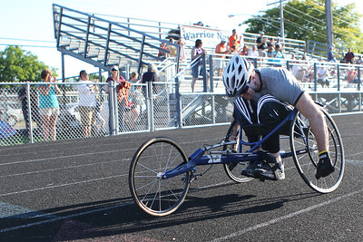 Mike Greene - mgreene@shawmedia.com Bob Swanson, of Round Lake, pushes his cycle while competing during the 5th Annual Run & Roll Track Meet Wednesday, June 6, 2012 at McCracken Field in McHenry. The event included participants of all ages with physical and visual disabilities and showcased various adaptive sports equipment.
