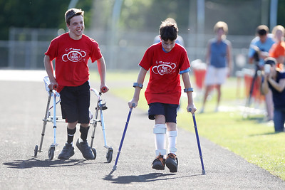 Mike Greene - mgreene@shawmedia.com Ben Spengel (left), 15 of McHenry, and Zachary Simons, 13 of Huntley, race during the 5th Annual Run & Roll Track Meet Wednesday, June 6, 2012 at McCracken Field in McHenry. The event included participants of all ages with physical and visual disabilitie.