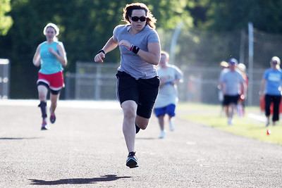 Mike Greene - mgreene@shawmedia.com Tiffany Melchiorre, of Waukegan, races during the 5th Annual Run & Roll Track Meet Wednesday, June 6, 2012 at McCracken Field in McHenry. The event included participants of all ages with physical and visual disabilitie.