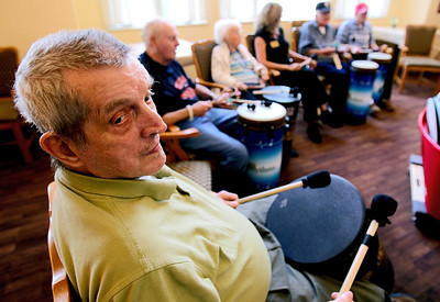 Sarah Nader - snader@shawmedia.com Harry Boucher of McHenry keeps the beat going while participating in a therapeutic drum circle for residents at Fox Point Manor Assisted Living Facility in McHenry on Thursday, June 7, 2012.