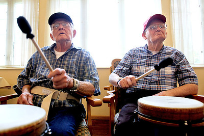 Sarah Nader - snader@shawmedia.com Jack Berry (left) and Ray Block both of McHenry keep the beat going while participating in a therapeutic drum circle for residents at Fox Point Manor Assisted Living Facility in McHenry on Thursday, June 7, 2012.
