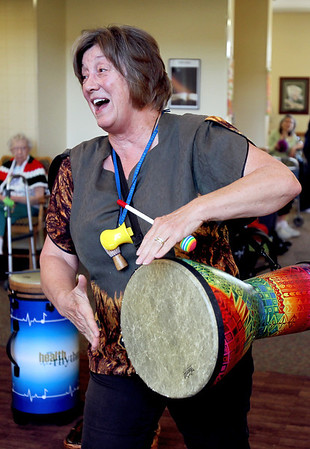 """Sarah Nader - snader@shawmedia.com Phyllis Mueller, owner of Parksong, Ltd. """"Drumming for Health"""" starts a drum circle for resident  at Fox Point Manor Assisted Living Facility in McHenry on Thursday, June 7, 2012."""