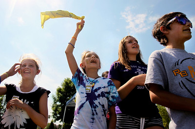 Sarah Nader - snader@shawmedia.com Kayly Hogan (left), 11,  Kylie Felt, 10, Emily Pitter, 12, and Callin Felt, 12, all of Spring Grove, try to get cars to stop while running their Alex's Lemonade Stand in Spring Grove during National Lemonade Days on Friday, June 8, 2012. The National Lemonade Days is an annual campaign by Alex's Lemonade Stand Foundation to fundraise for childhood cancer research.