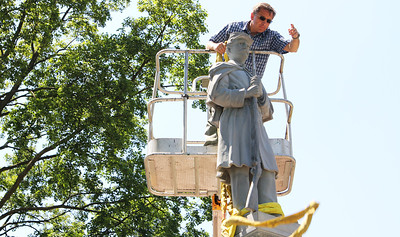 Morgan Ellingson - mellingson@shawmedia.com Andrzej Dajnowski (cq), removes tethers on newly restored Civil War Statue in Union Cemetery in Crystal Lake, on Friday, June 8, 2012. After six years of restoration, the 120 year-old Civil War monument is again on display.
