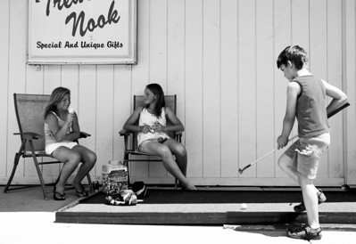 Sarah Nader - snader@shawmedia.com  Meggie Bokowy (left), 11, of Marengo and Riley Connell, 11 of McHenry take am ice cream break while Dakota Horn (right), 6, plays a hole of golf sixth annual Putt-Putt Challenge in downtown Marengo on Saturday, June 9, 2012. Participating Marengo business and organizations throughout the downtown area each built miniature golf holes to challenge and entertain participants.