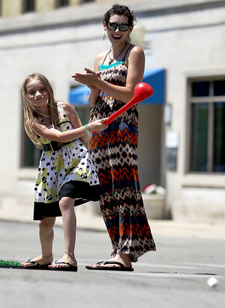 Sarah Nader - snader@shawmedia.com Jenni Shacklee (right) of Marengo watches her daughter, Savannah, 7, while they participated in the sixth annual Putt-Putt Challenge in downtown Marengo on Saturday, June 9, 2012. Participating Marengo business and organizations throughout the downtown area each built miniature golf holes to challenge and entertain participants.