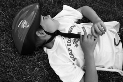 Sarah Nader - snader@shawmedia.com Ethan Kwasigroch, 10, of McHenry takes a break while competing in the 10th annual Kiwanis Soap Box Derby in McHenry on June, 9, 2012.