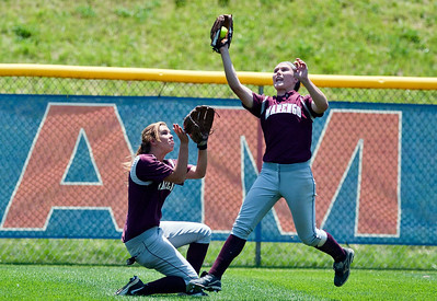 Skyler Edwards/For the Northwest Herald Marengo's Reed Karsten makes a catch while Megan Semro backs her up during the fifth inning of the IHSA Class 3A Championship Game against Glenbard South at EastSide Centre in East Peoria.