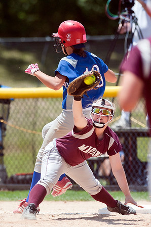 Skyler Edwards/For the Northwest Herald Marengo's Abby Kissack tries to tag Glenbard South's Tarah Valdez out at first during the fourth inning of the IHSA Class 3A Championship Game at EastSide Centre in East Peoria.
