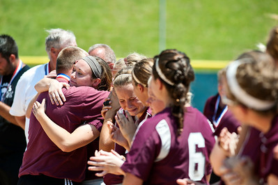 Skyler Edwards/For the Northwest Herald Marengo Indians' head coach Dwain Nance hugs Reed Karsten after the IHSA Class 3A Championship Game Saturday against Glenbard South in East Peoria. Marengo takes home second place after Glenbard beat them out 2-1.