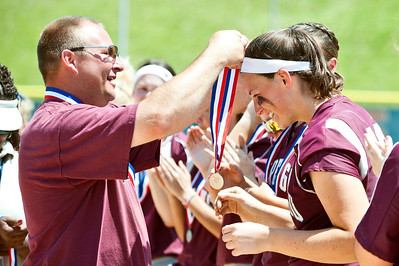 Skyler Edwards/For the Northwest Herald Marengo Indians' head coach Dwain Nance places a medal on Lindsay Melson after taking home second at the IHSA Class 3A Championship Game Saturday against Glenbard South in East Peoria.