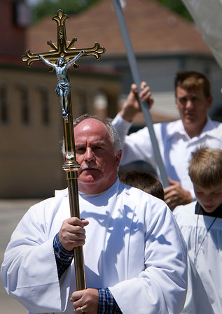 St. Patrick's Church Eucharist Minister Tim Madden, from McHenry, leads the traditional Corpus Christi procession on Pearl Street in McHenry Sunday June 10, 2012.  John Konstantaras photo for the Northwest Herald